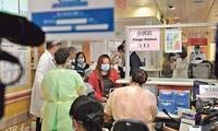 港澳政府积极应对流感高峰 打疫苗、停课多管齐下